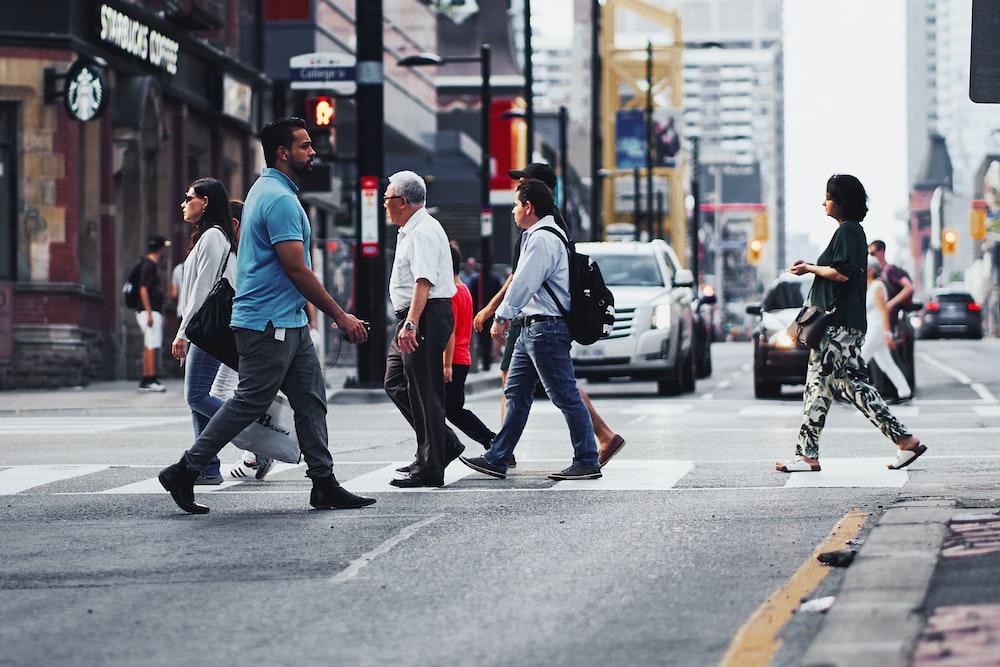 people walking on road during daytime