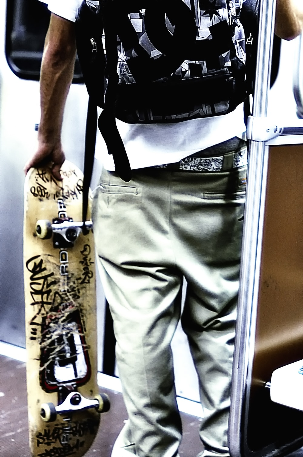 unknown person holding brown skateboard
