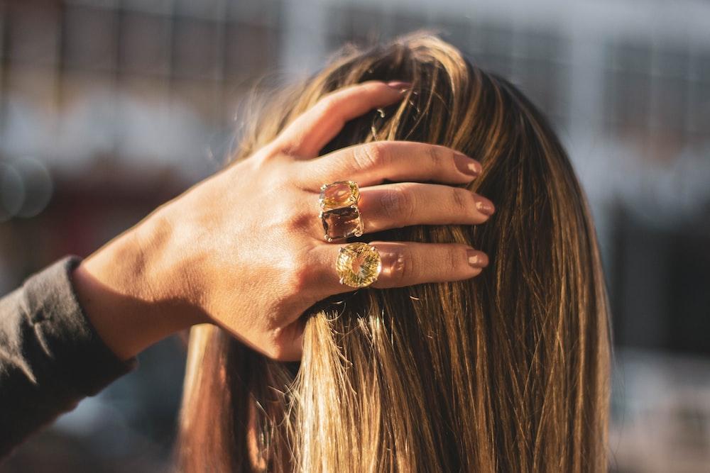 brunette woman holding her hair