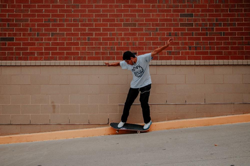 man doing skateboard tricks on sidewalk