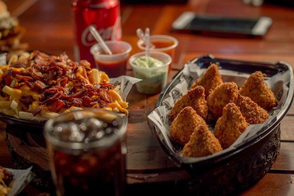 fried foods on black plate
