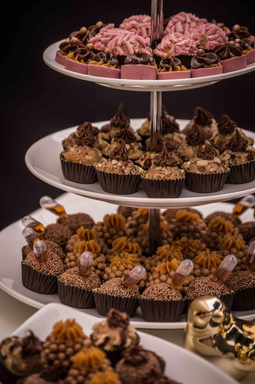 variety of cupcakes on cupcake rack