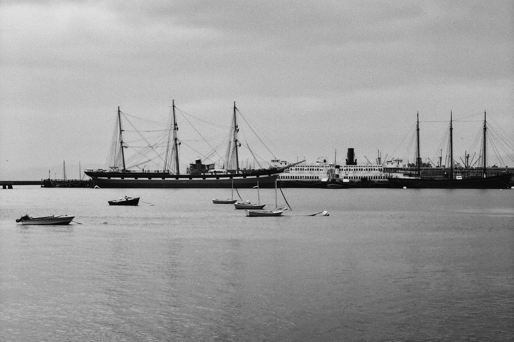 grayscale photography of ships