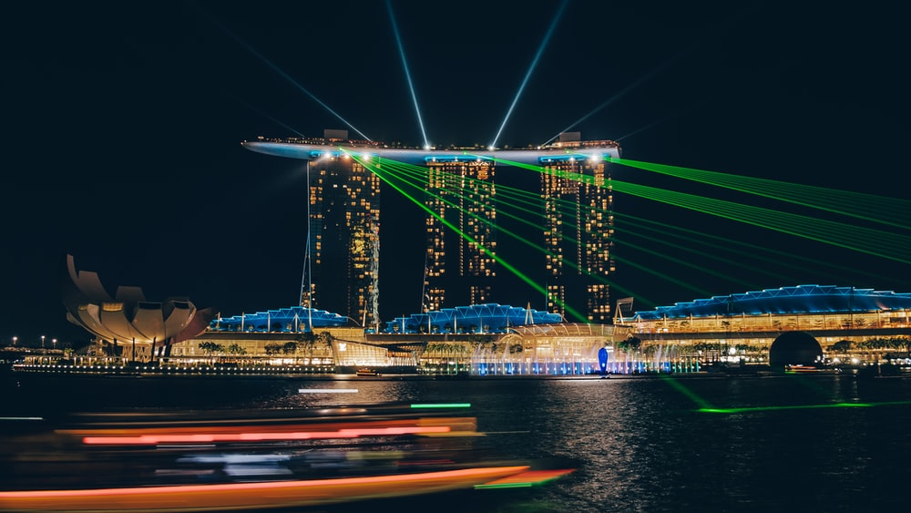 lighted high-rise buildings near body of water