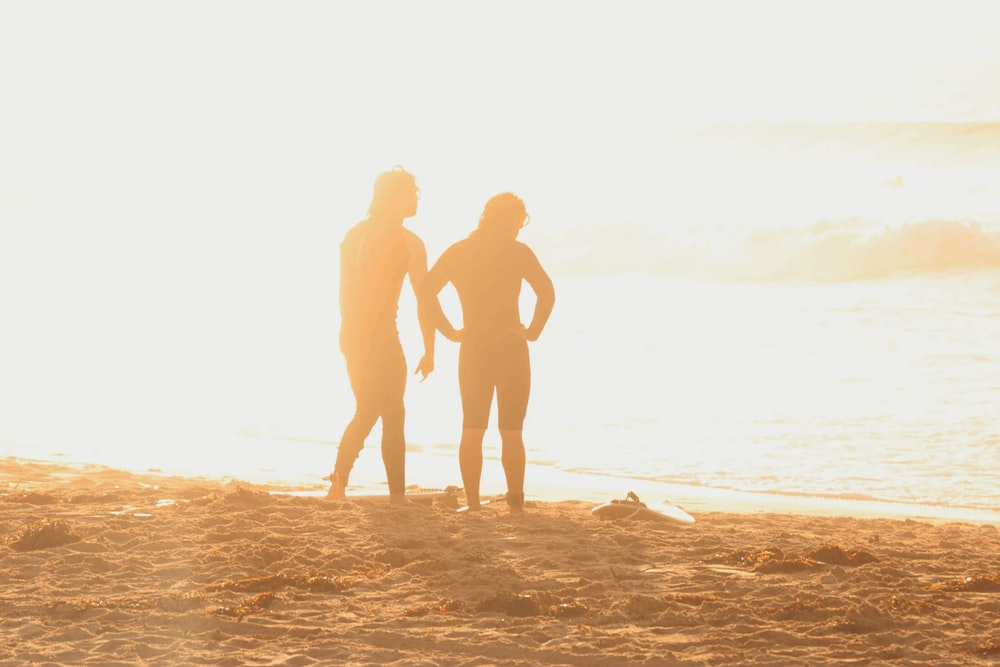 two persons on seashore