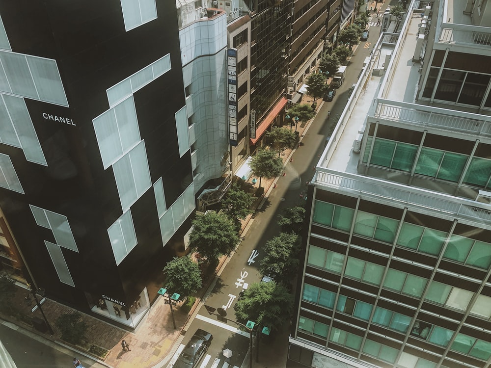 street between concrete high-rise building during daytime