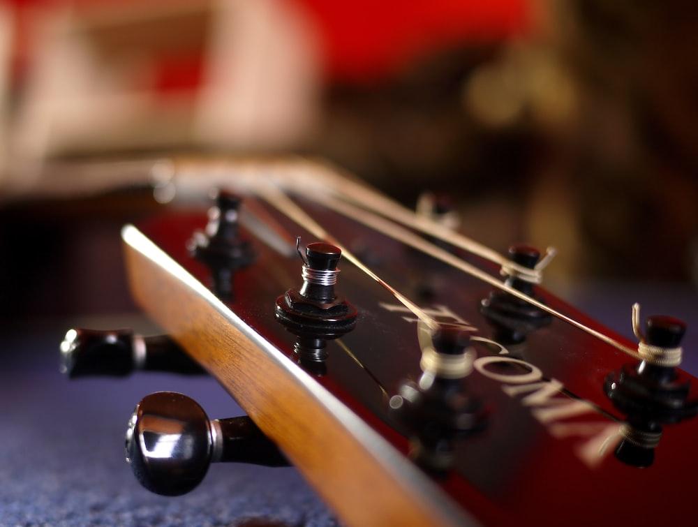 brown guitar close-up photography