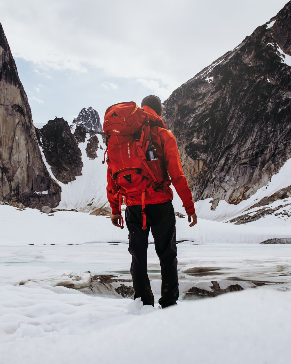 man carrying hiking backpack
