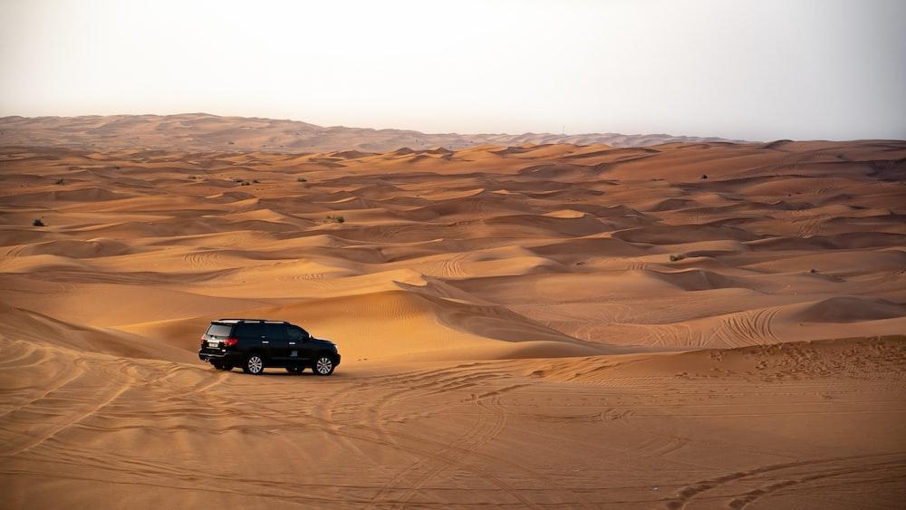 car on vast desert