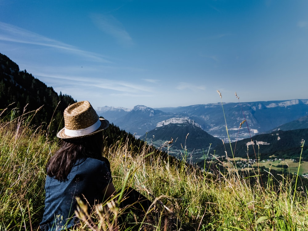woman sits on mountain
