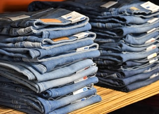 pile of blue denim jeans lot