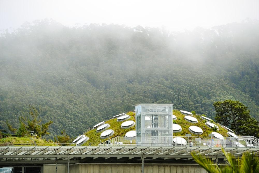 clear glass building near mountain