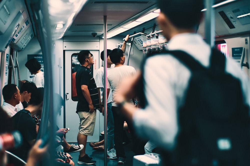 men and women inside a train