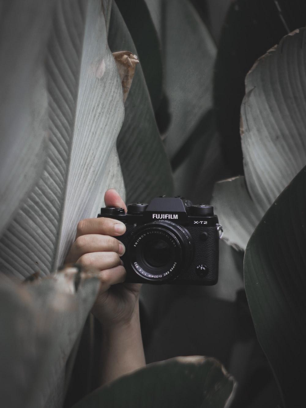 black Fujifilm DSLR camera