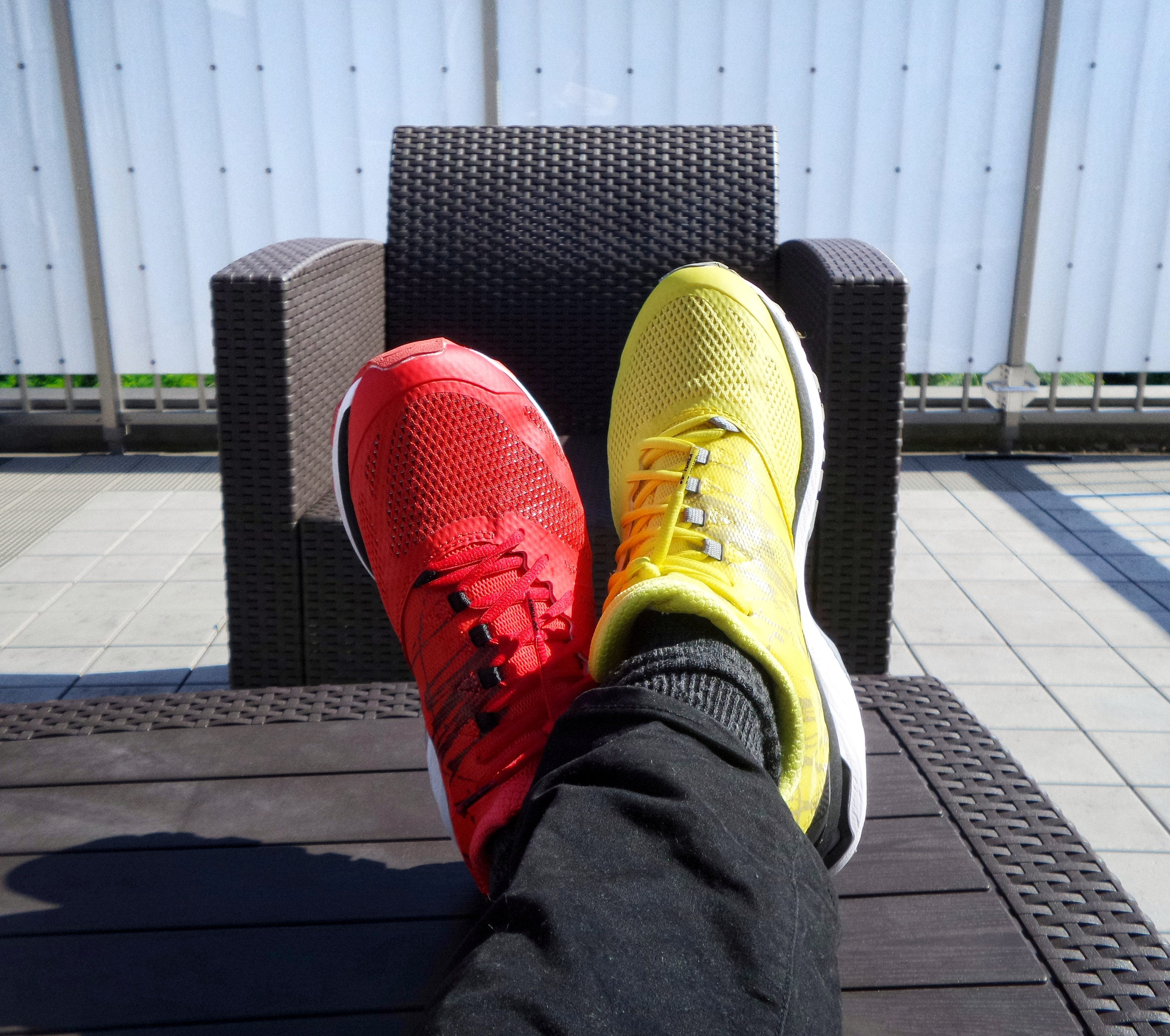 pair of red-and-yellow sneakers