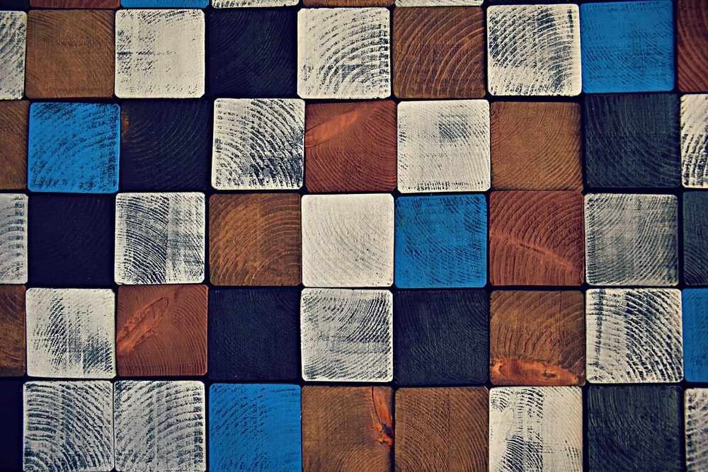 pile of brown and blue wood