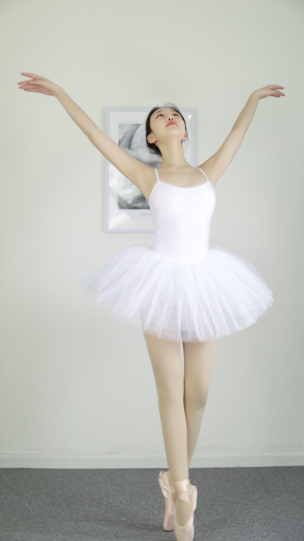 woman wearing white ballerina dress
