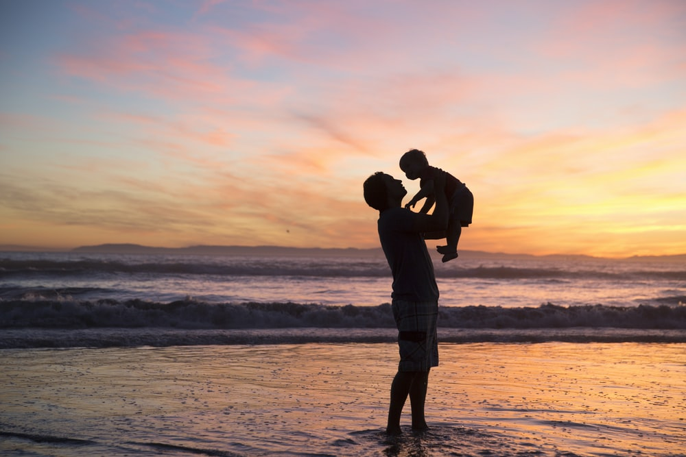 silhouette of man and kid