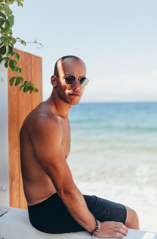 man sitting on white wooden frame
