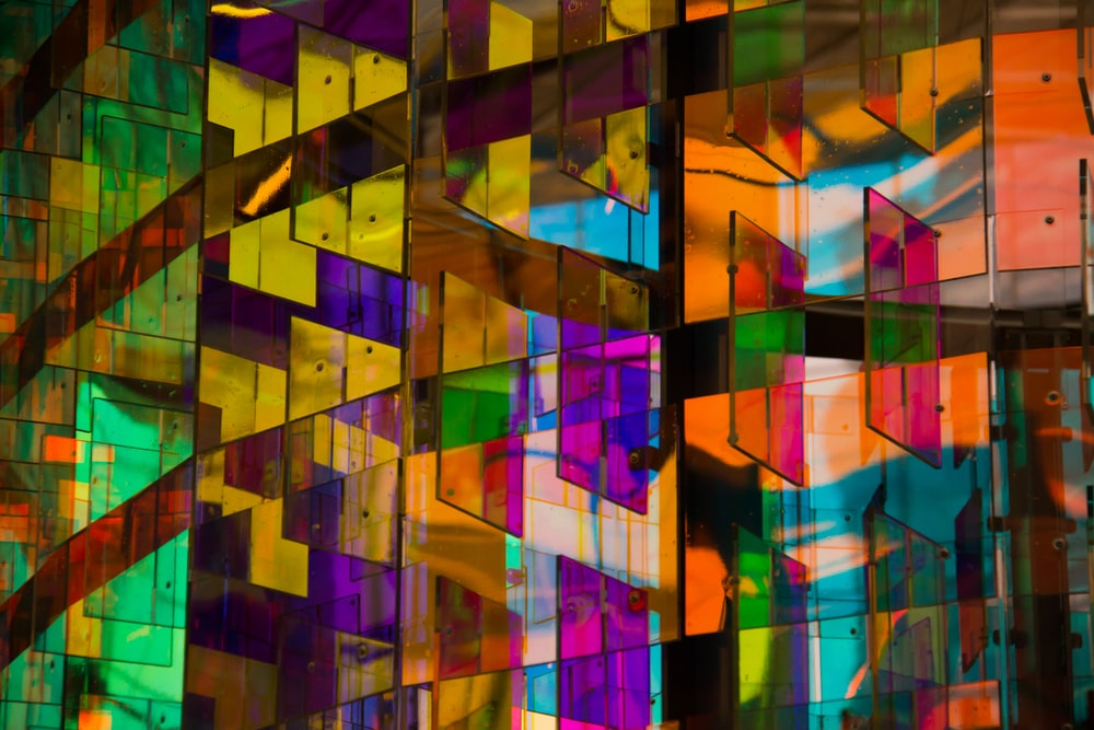 architectural photography of multicolored glass board