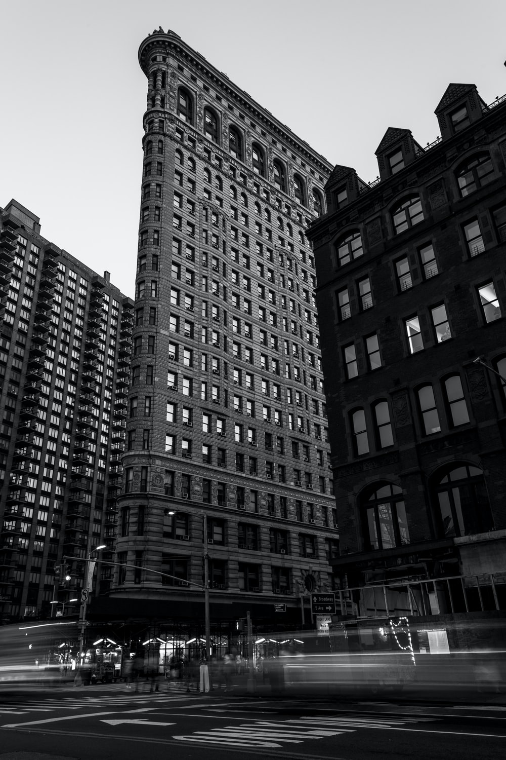 grayscale photography Flatiron Building in New York City