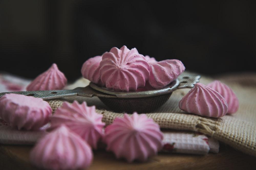 pink meringues on white textile