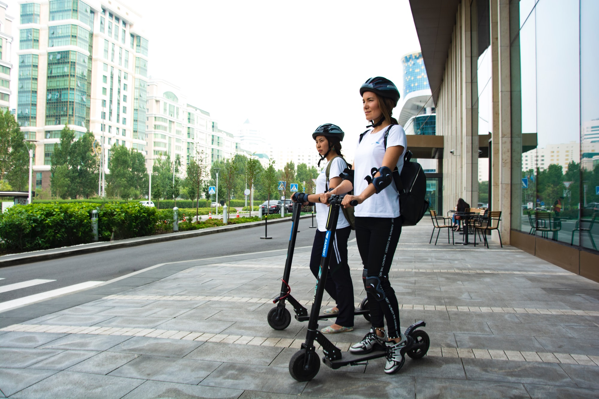 Kazakh postman \Kazpost\ Kazakhstan\ Nur-Sultan\ Girls\ Scooter\ Town