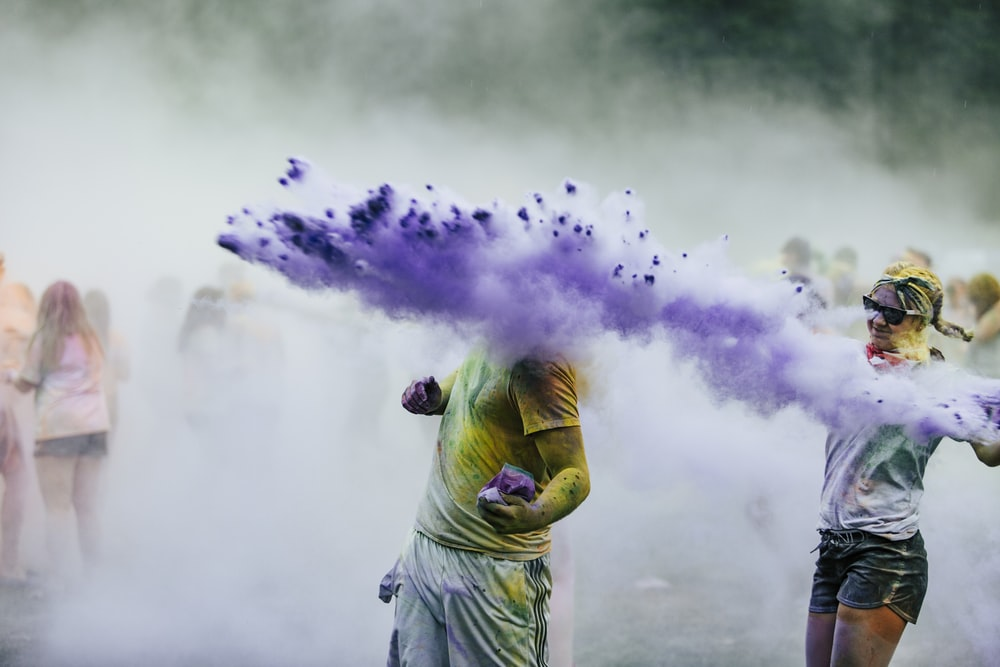 person with purple smoke