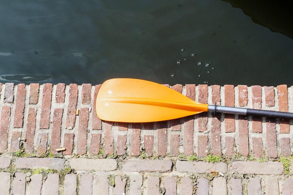 orange boat paddle