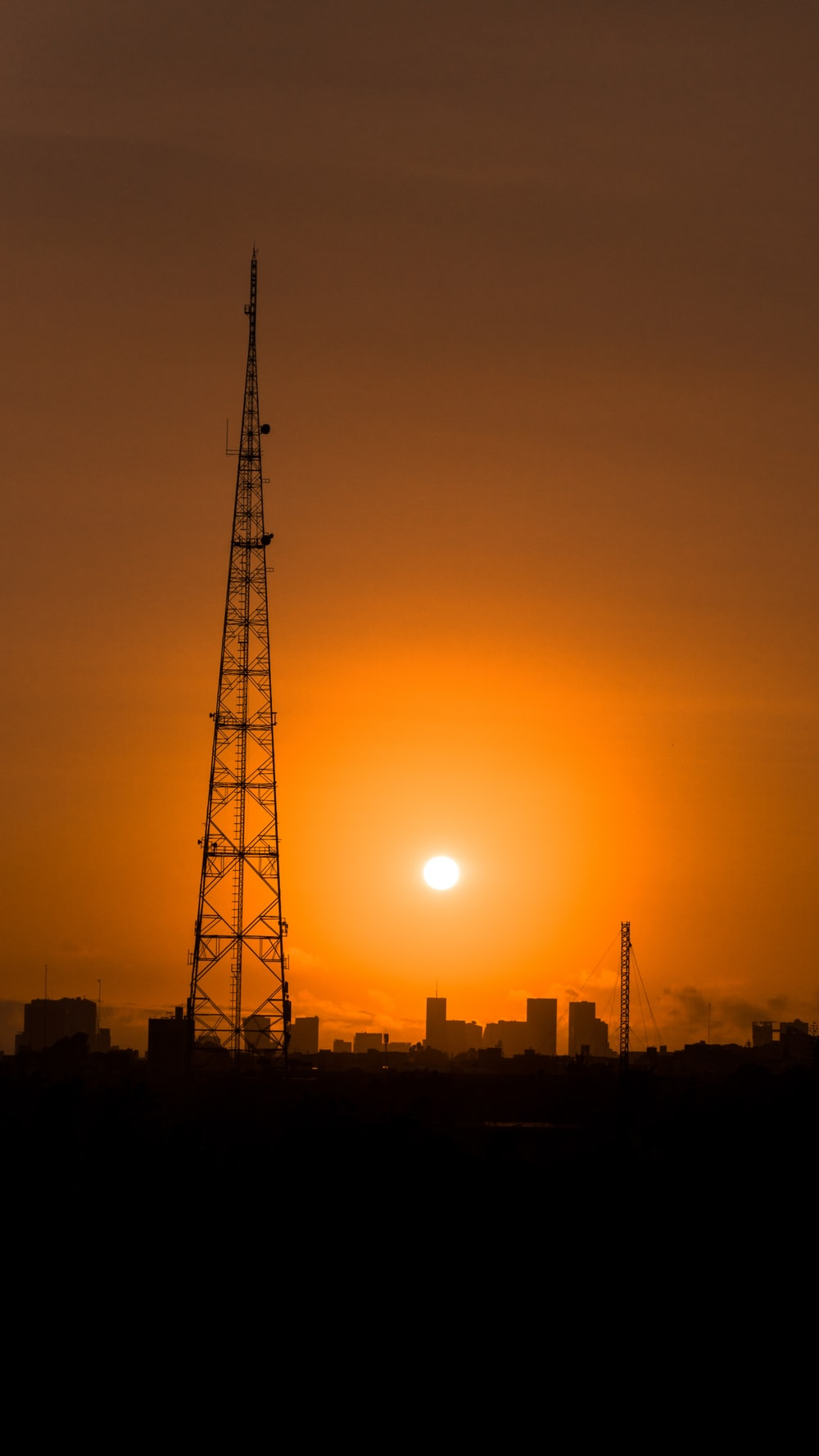 silhouette of metal tower during golden hour