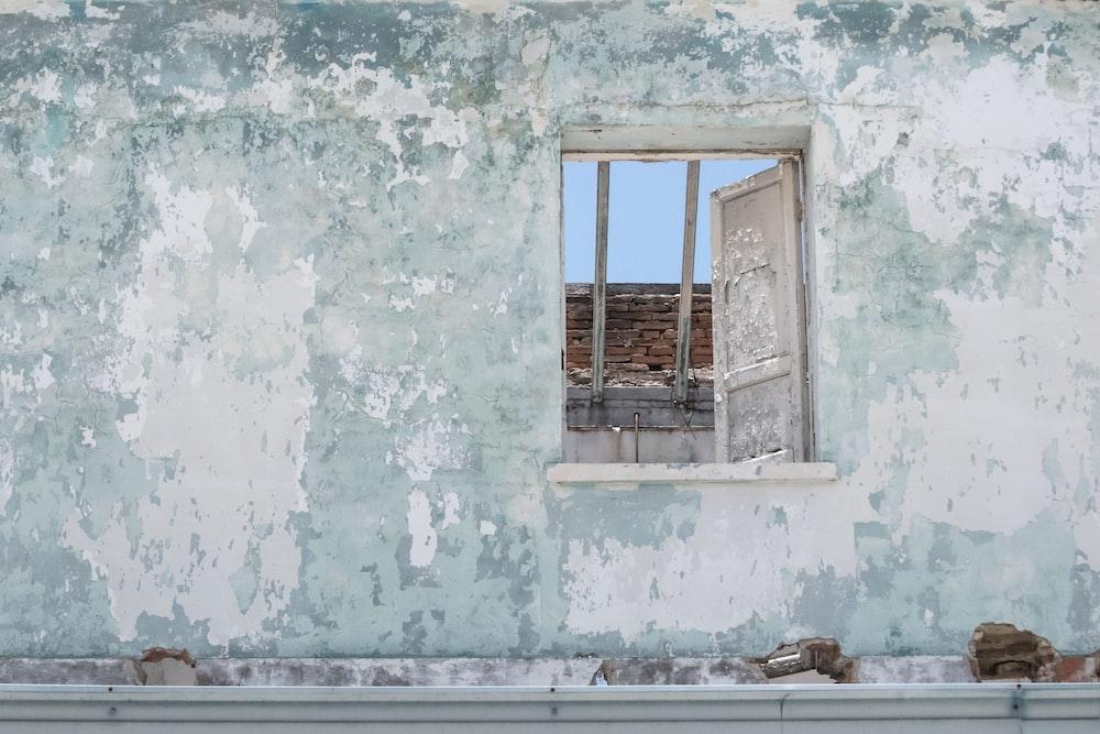 white window on concrete wall