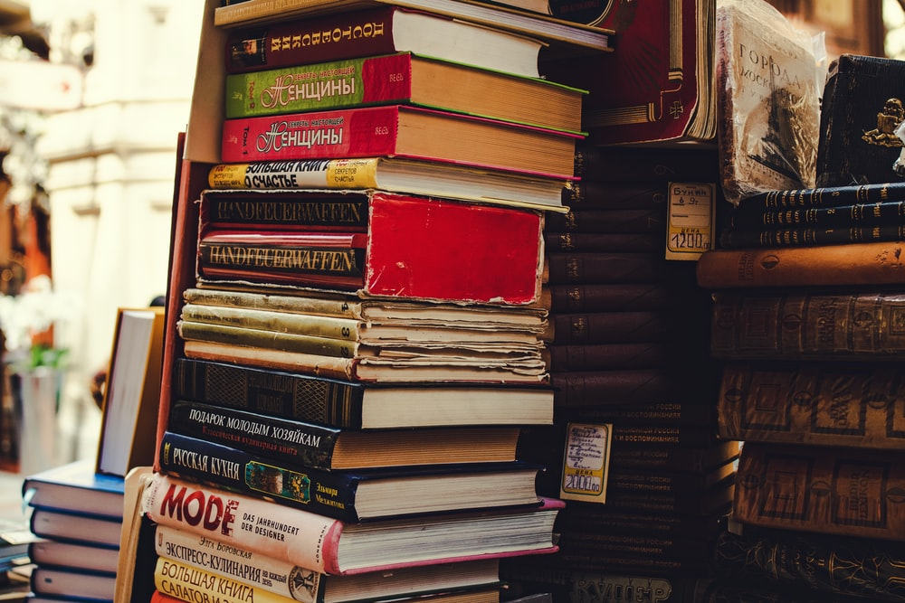 pile of assorted-title hardbound books