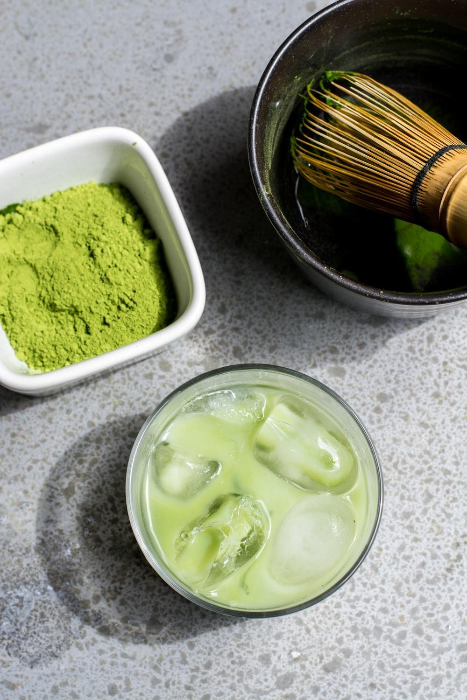 green powder in white bowl