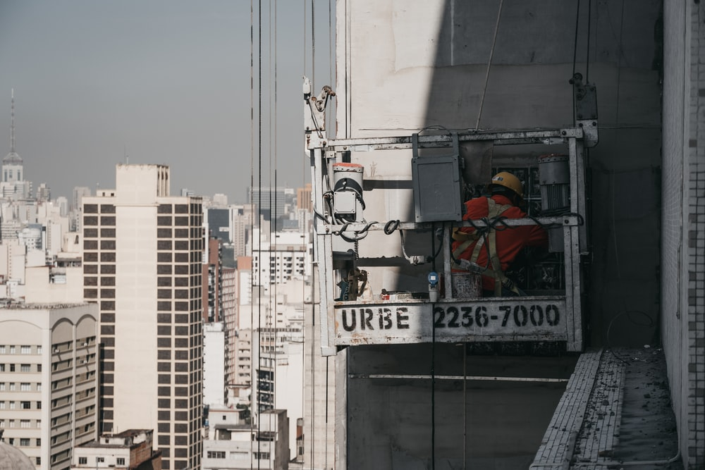 man working on building