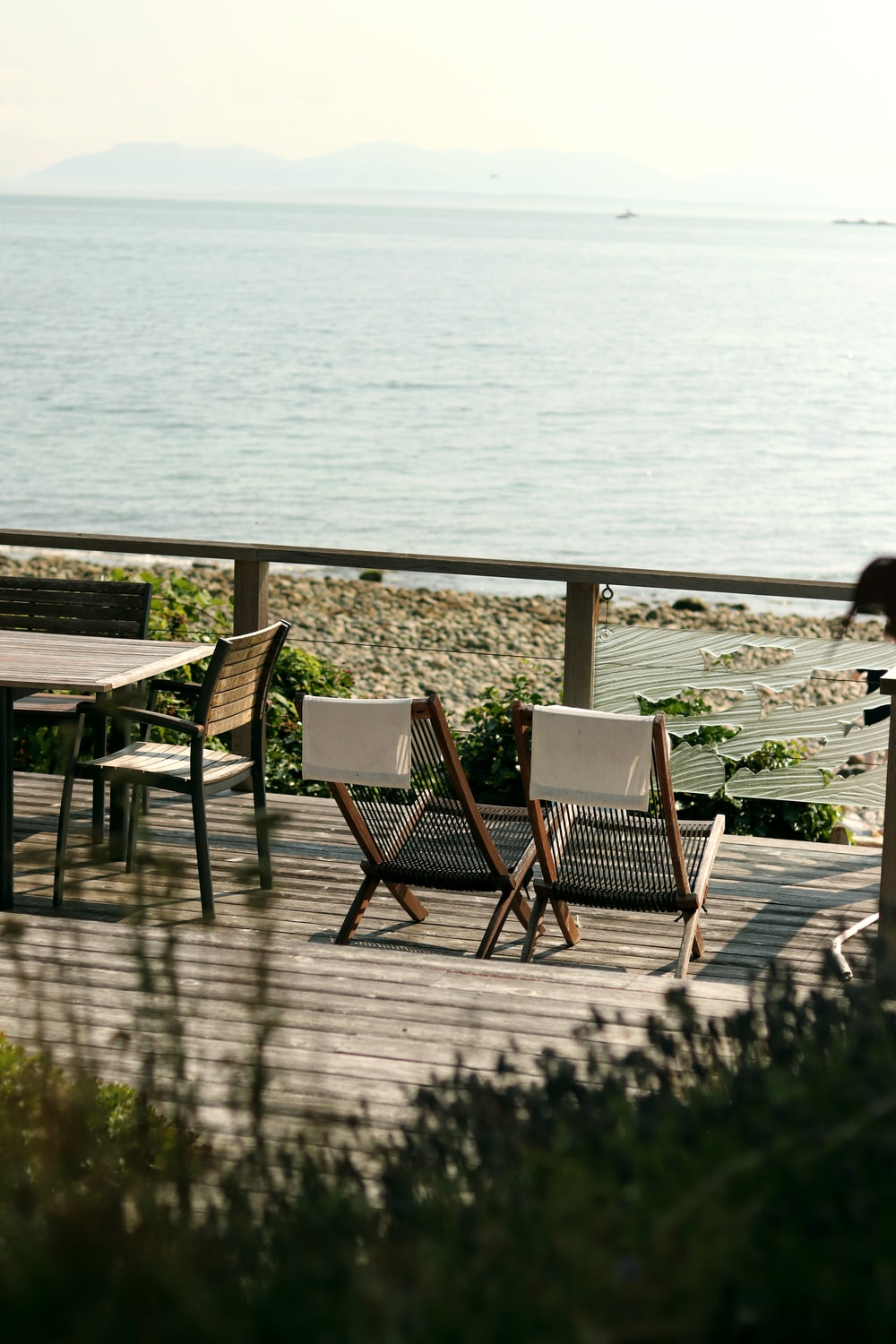 tables and chairs near seashore