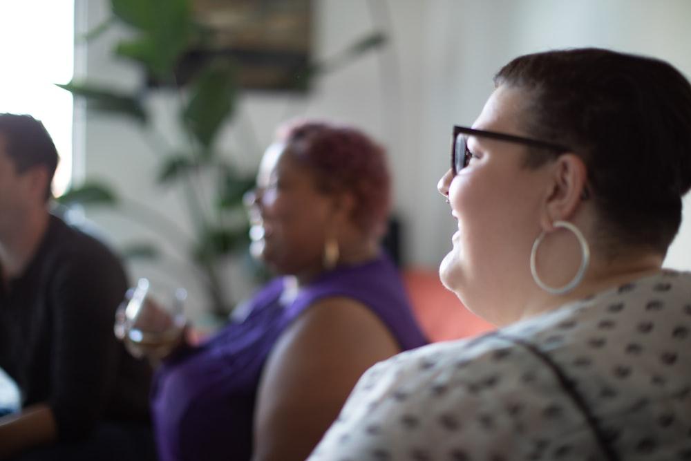 woman in white shirt beside woman in purple tank top