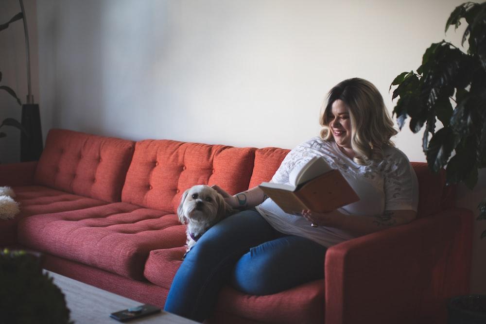 woman and dog on sofa