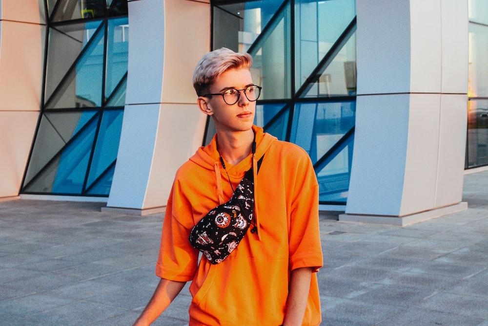 man wearing orange shirt