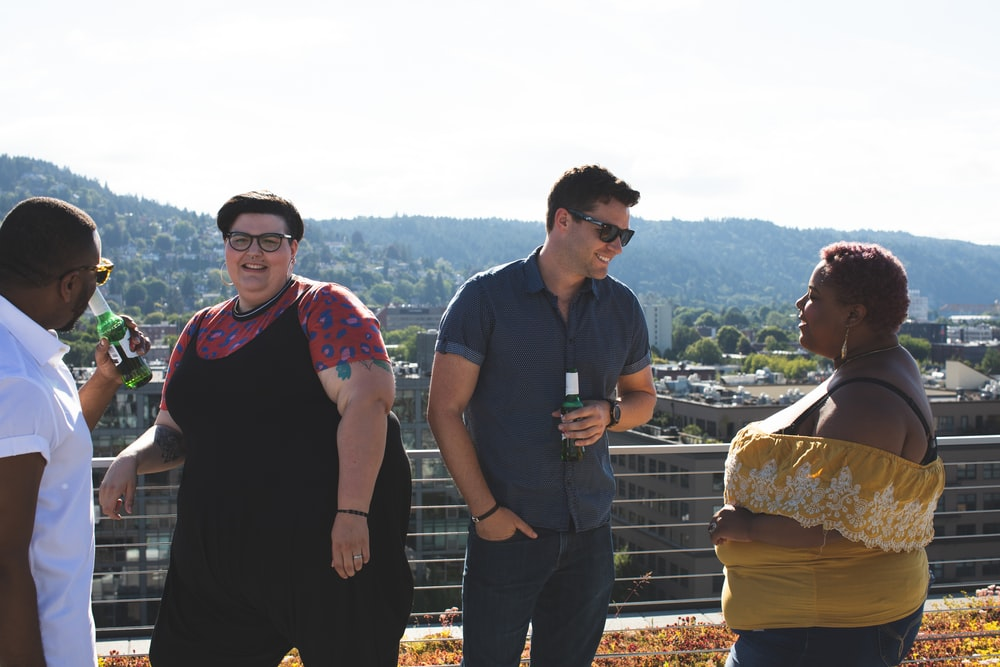 two couples on a balcony