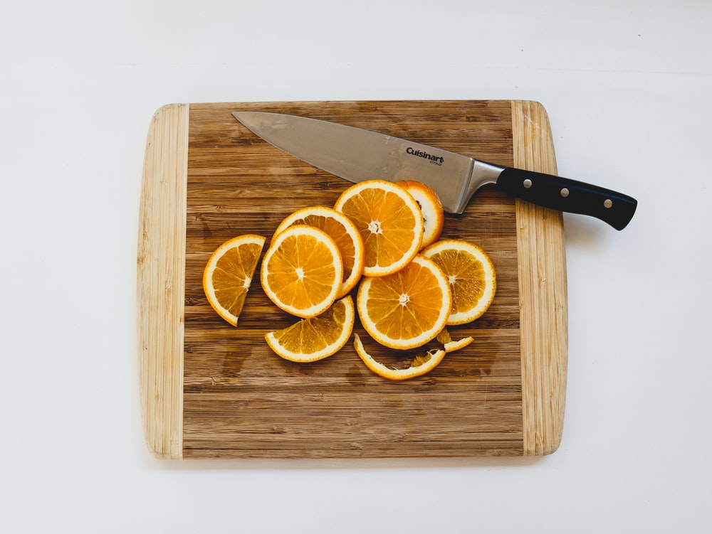 sliced oranges on chopping board