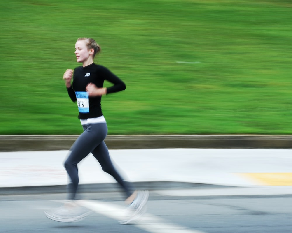 girl running outdoor during daytime