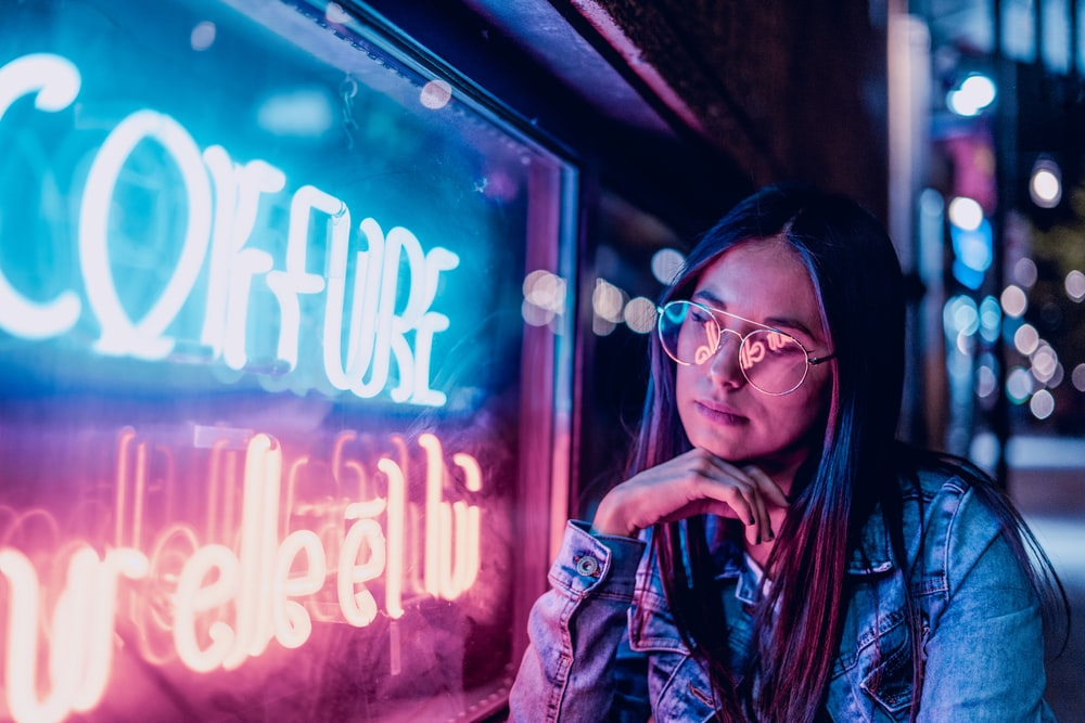 woman near lighted signage