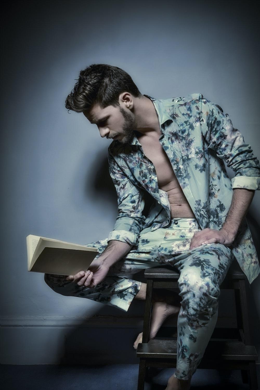 man reading book while sitting