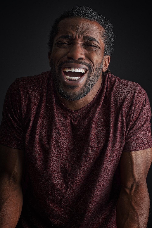 smiling man wearing brown t-shirt