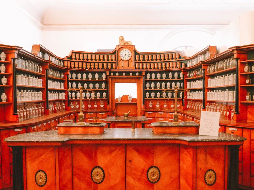 displayed jars on brown wooden shelves