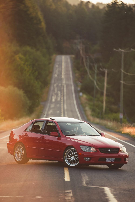 red Lexus sedan on road