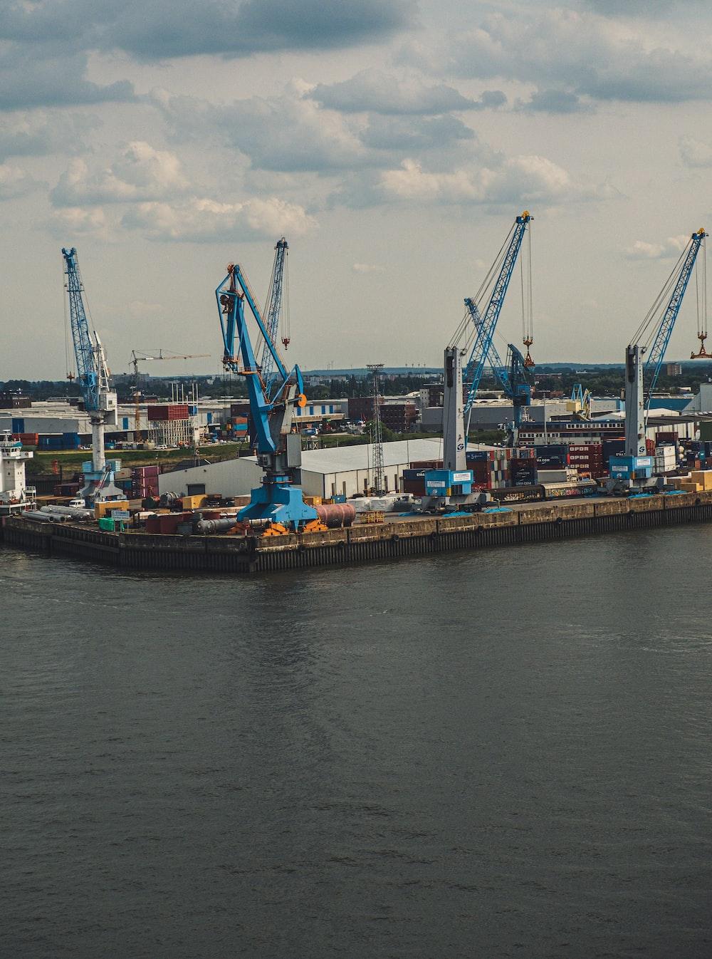 blue metal cranes at a dock
