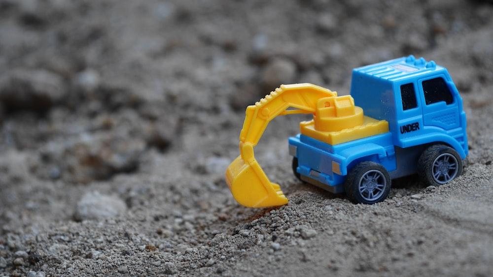 blue backhoe toy on sad