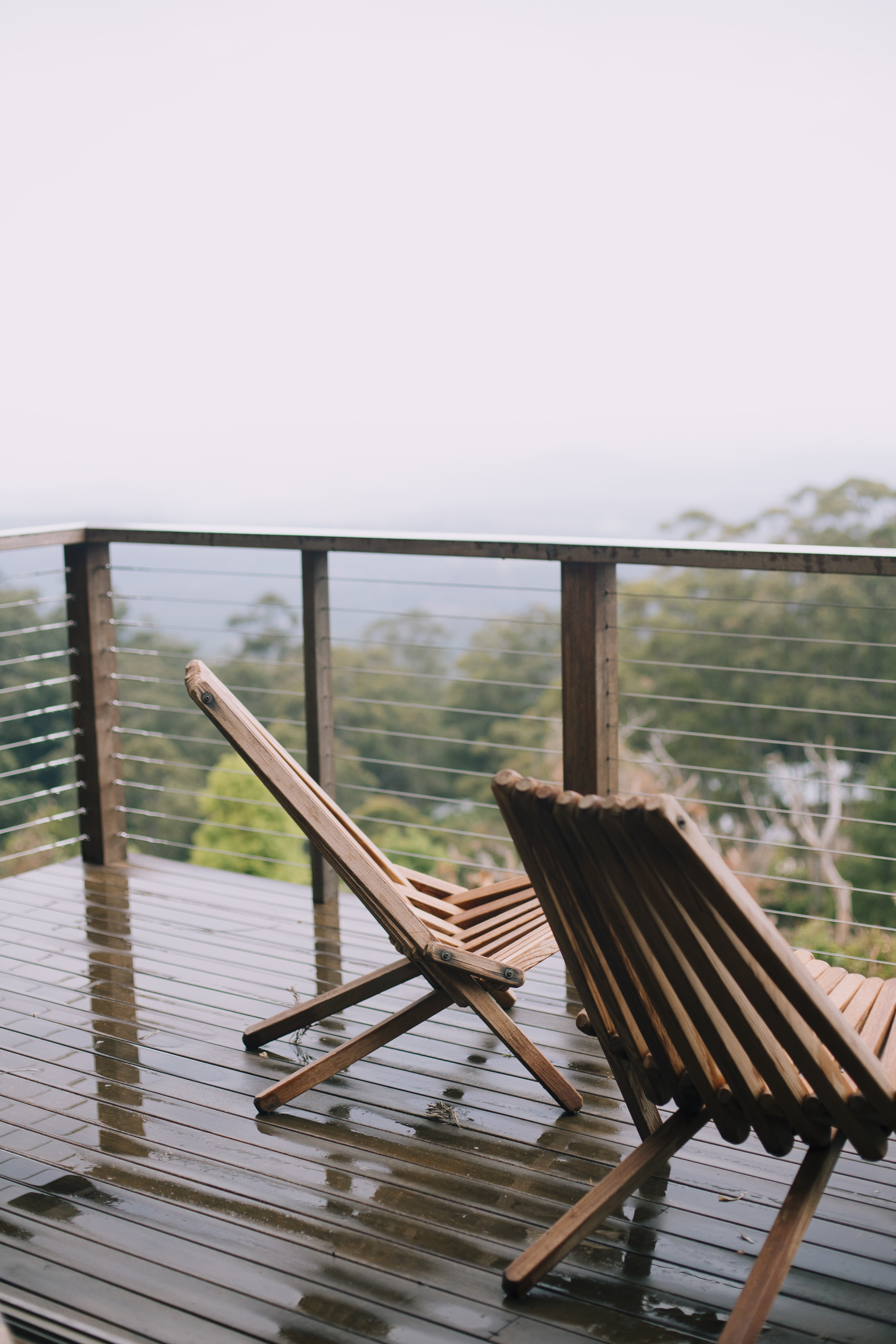 Picture of: Two Brown Wooden Folding Lounge Chairs At The Balcony Photo Free Australia Image On Unsplash