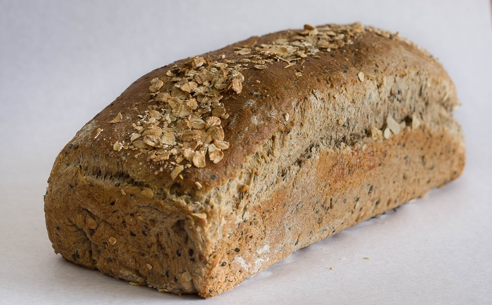 baked loft bread on white surface